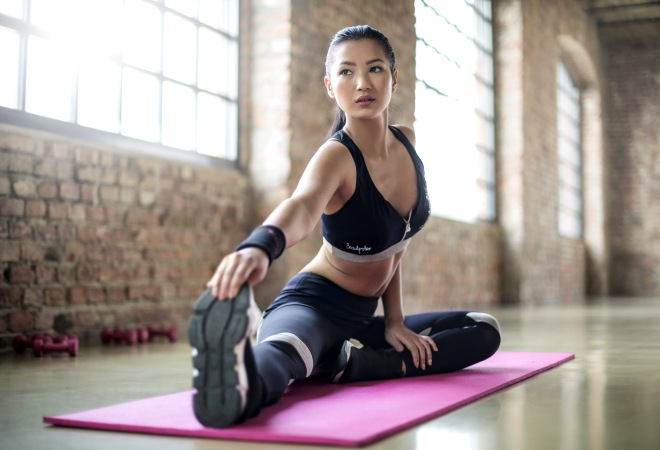 woman-stretching-on-mat